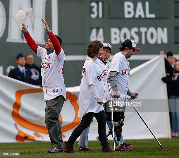 Carlos Arredondo first responder during the 2013 Boston Marathon bombing and Jeff Bauman far right react during a ceremony at Fenway Park before a...