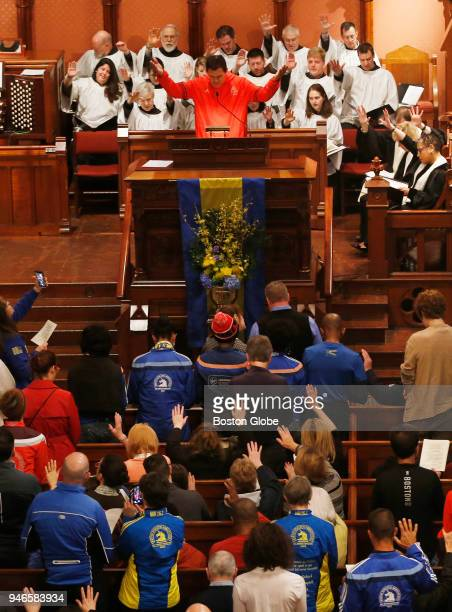 Carlos Arredondo leads the congregation in prayer during a special The Blessing of the Athletes service at the Old South Church on April 15 the five...