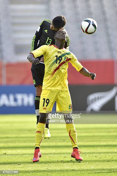 Carlos Arreola of Mexico clashes with Adama Traore of Mali during FIFA's Under20 World Cup's football match between Mexico and Mali in Dunedin on May...