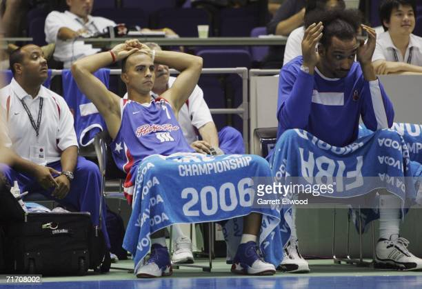 Carlos Arroyo and Peter John Ramos of Puerto Rico sit on the bench during the game against Italy during the preliminary round of FIBA World...