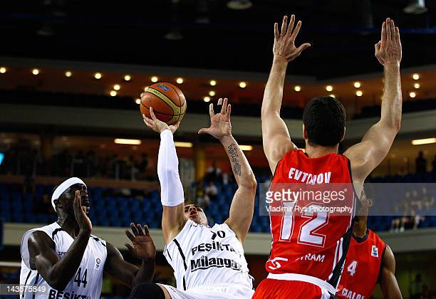 Carlos Arroyo of Besiktas is defended by Ilian Evtimov of Chalon during the FIBA Europe EuroChallenge Final Four final game between Besiktas Milangaz...