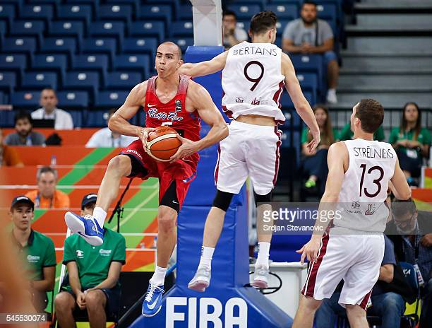 Carlos Arroyo of Puerto Rico in action against Dairis Bertans and Janis Strelnieks of Latvia during the 2016 FIBA World Olympic Qualifying basketball...