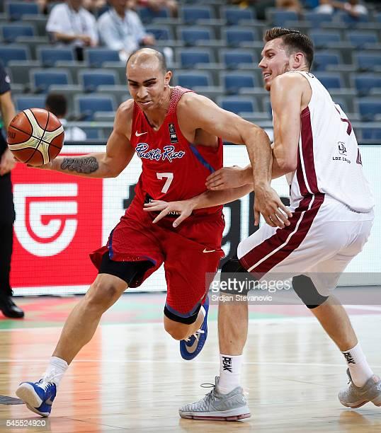 Carlos Arroyo of Puerto Rico in action against Dairis Bertans of Latvia during the 2016 FIBA World Olympic Qualifying basketball Semi Final match...