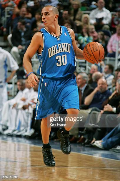 Carlos Arroyo of the Orlando Magic dribbles the ball against the Utah Jazz March 6, 2006 at the Delta Center in Salt Lake City, Utah. NOTE TO USER:...