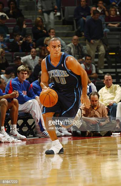 Carlos Arroyo of the Utah Jazz moves the ball during the preseason game with the Detroit Pistons at The Palace of Auburn Hills on October 24 2004 in...