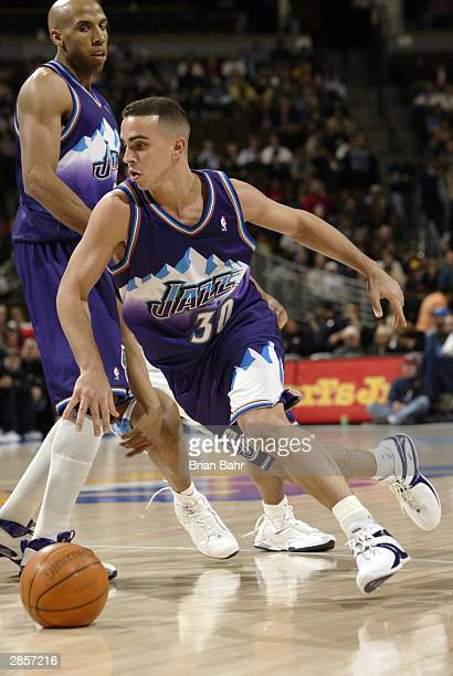Carlos Arroyo of the Utah Jazz runs the pick and roll against the Denver Nuggets in the first quarter January 9 2004 at the Pepsi Center in Denver...