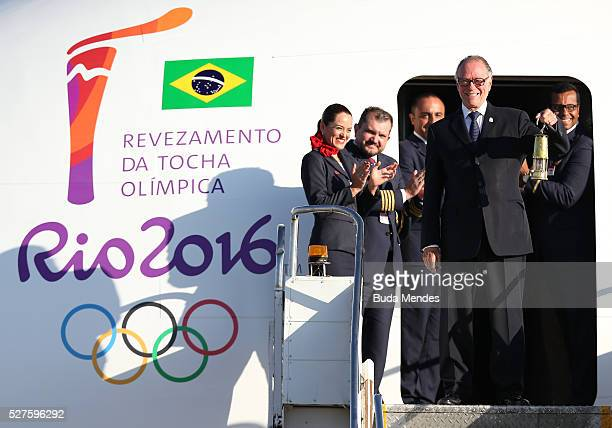 Carlos Arthur Nuzman President of Rio 2016 steps from the plane with the Olympic flame arriving from Geneva on May 3 2016 in Brasilia Brazil The...