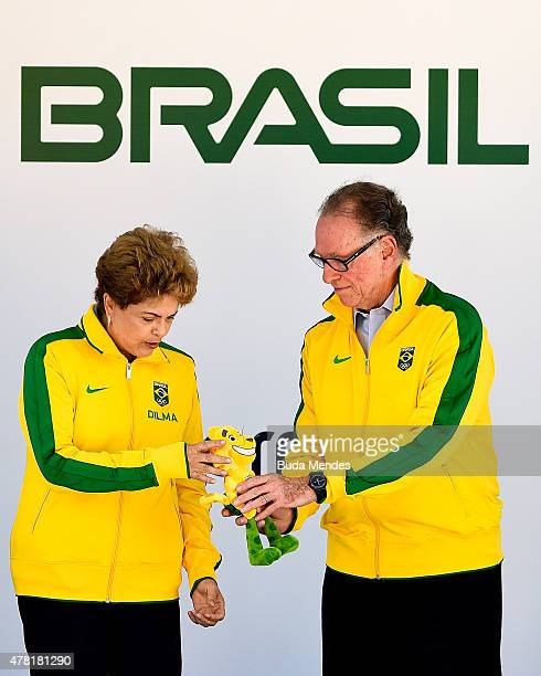Carlos Arthur Nuzman, President of the Organizing Committee for the Rio 2016 Olympics presents a miniature of the Brazilian national team's mascot,...