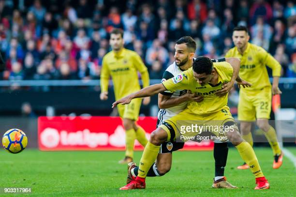 Carlos Arturo Bacca Ahumada of Villarreal CF fights for the ball with Martin Montoya Torralbo of Valencia CF during the La Liga 201718 match between...