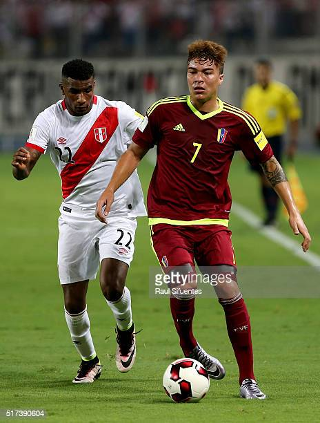 Carlos Ascues of Peru struggles for the ball with Adalberto Penaranda of Venezuela during a match between Peru and Venezuela as part of FIFA 2018...
