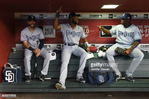 Carlos Asuaje Manuel Margot and Jose Pirela of the San Diego Padres sit in the dugout prior to the MLB game against the Arizona Diamondbacks at Chase...