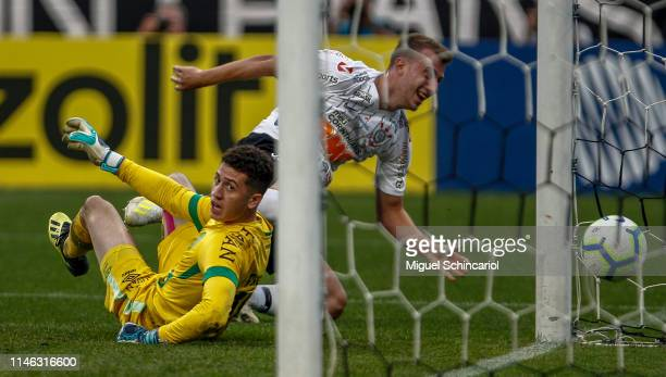 Carlos Augusto of Corinthians scores the opening goal against goalkeeper Tiepo of Chapecoense during a match between Corinthians and Chapecoense for...