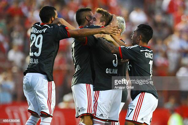 Carlos Auzqui of Estudiantes celebrates with his teammates after scoring the second goal of his team during a match between Argentinos Juniors and...