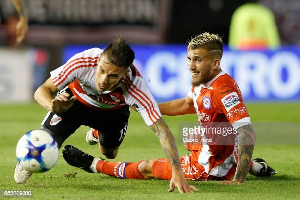 Carlos Auzqui of River Plate fights for the ball with Gonzalo Piovi of Argentinos Juniors during a match between River Plate and Argentinos Juniors...