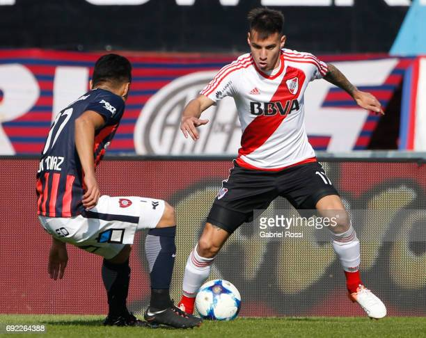 Carlos Auzqui of River Plate fights for the ball with Paulo Diaz of San Lorenzo during a match between San Lorenzo and River Plate as part of Torneo...