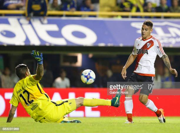 Carlos Auzqui of River Plate kicks the ball over Agustin Rossi goalkeeper of Boca Juniors during a match between Boca Juniors and River Plate as part...