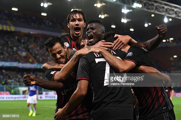 Carlos Bacca of AC Milan celebrates after scoring the opening goal with team mates during the Serie A match between UC Sampdoria and AC Milan at...