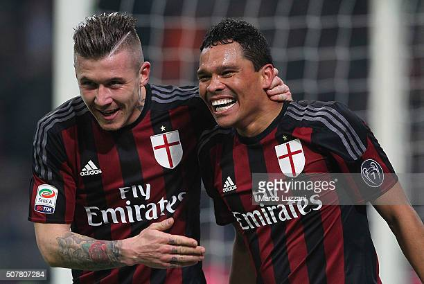 Carlos Bacca of AC Milan celebrates his goal with his teammate Juraj Kucka during the Serie A match between AC Milan and FC Internazionale Milano at...