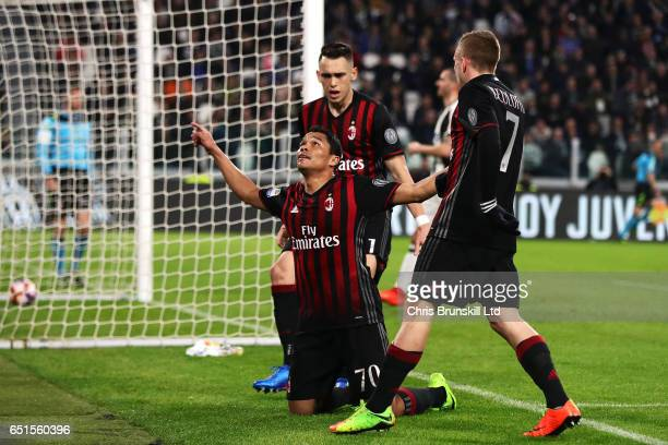 Carlos Bacca of AC Milan celebrates scoring his team's first goal to make the score 11 during the Serie A match between Juventus FC and AC Milan at...