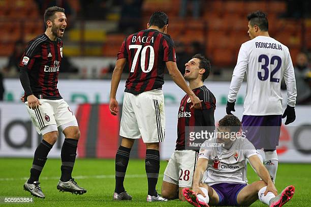 Carlos Bacca of AC Milan celebrates with his teammates Andrea Bertolacci and Giacomo Bonaventura after scoring the opening goal during the Serie A...
