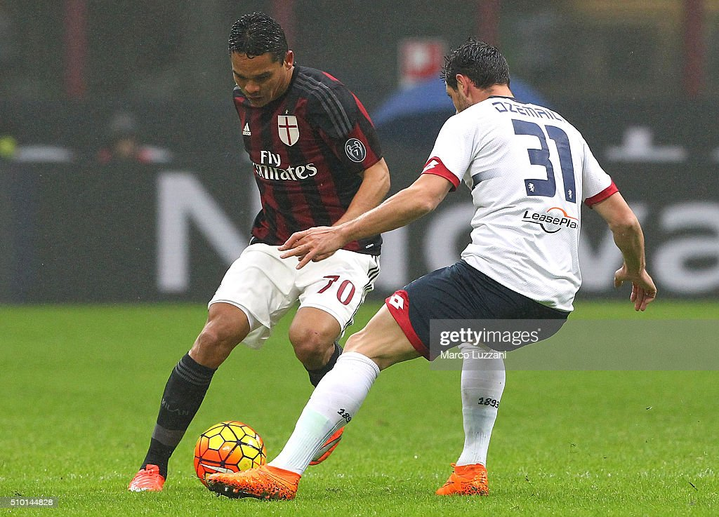 Carlos Bacca of AC Milan competes for the ball with Blerim Dzemaili of Genoa CFC during the Serie A match between AC Milan and Genoa CFC at Stadio Giuseppe Meazza on February 14, 2016 in Milan, Italy.