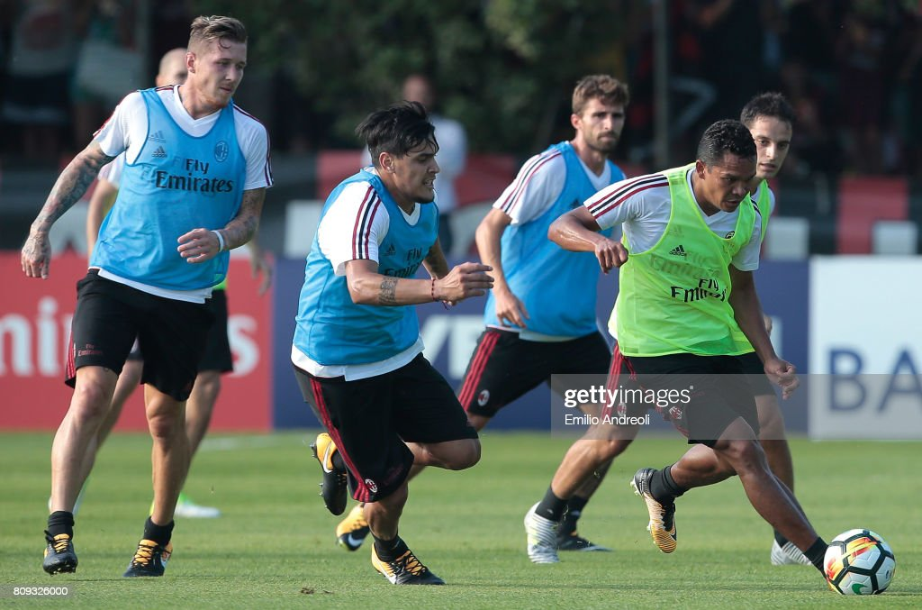 Carlos Bacca of AC Milan (R) competes for the ball with his teammate Gustavo Gomez (C) during the AC Milan training session at the club's training ground Milanello on July 5, 2017 in Cairate, Italy.