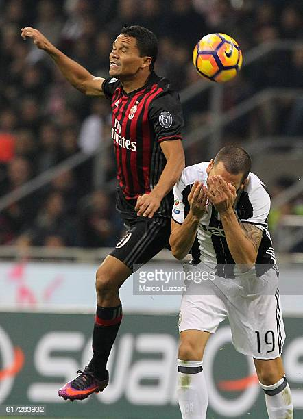 Carlos Bacca of AC Milan competes for the ball with Leonardo Bonucci of Juventus FC during the Serie A match between AC Milan and Juventus FC at...
