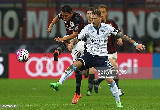 Carlos Bacca of AC Milan competes for the ball with Lucas Biglia of SS Lazio during the Serie A match between AC Milan and SS Lazio at Stadio...