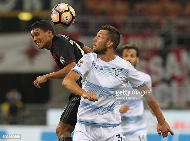 Carlos Bacca of AC Milan competes for the ball with Stefan de Vrij of SS Lazio during the Serie A match between AC Milan and SS Lazio at Stadio...