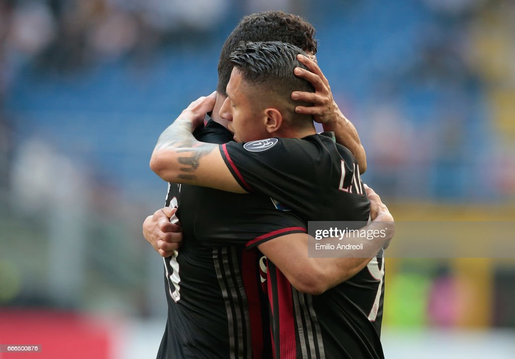 Carlos Bacca of AC Milan embraces Gianluca Lapadula of AC Milan during the Serie A match between AC Milan and US Citta di Palermo at Stadio Giuseppe Meazza on April 9, 2017 in Milan, Italy.