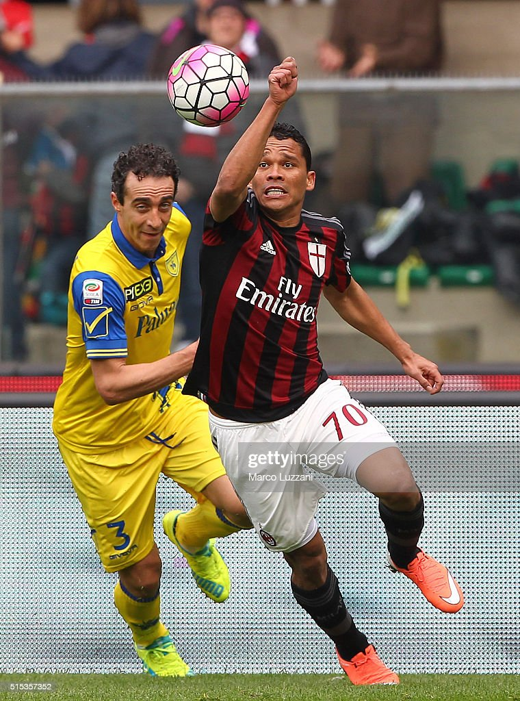 Carlos Bacca (R) of AC Milan is challenged by Dario Dainelli (L) of AC Chievo Verona during the Serie A match between AC Chievo Verona and AC Milan at Stadio Marc'Antonio Bentegodi on March 13, 2016 in Verona, Italy.