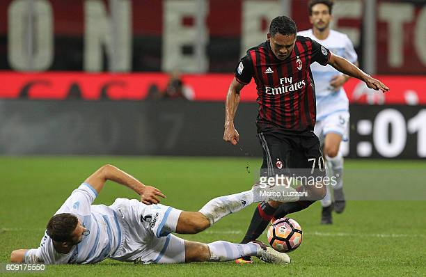 Carlos Bacca of AC Milan is challenged by Stefan de Vrij of SS Lazio during the Serie A match between AC Milan and SS Lazio at Stadio Giuseppe Meazza...