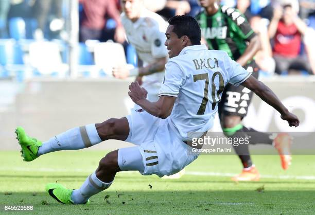 Carlos Bacca of AC Milan kicks the penalty and scores the opening goal during the Serie A match between US Sassuolo and AC Milan at Mapei Stadium...