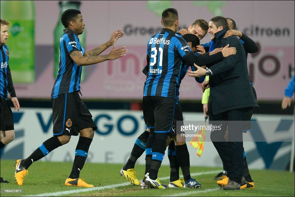 Carlos Bacca of Club Brugge KV celebrates scoring a goal with head coach Juan Carlos Garrido of Club Brugge KV during the Jupiler League match between SV Zulte Waregem and Club Brugge KV on March 9, 2013 in Waregem, Belgium.