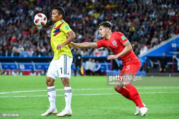 Carlos Bacca of Colombia and John Stones of England during the 2018 FIFA World Cup Russia Round of 16 match between Colombia and England at Spartak...