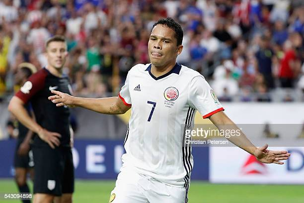 Carlos Bacca of Colombia celebrates his first half goal ahead of Matt Besler of United States during the 2016 Copa America Centenario third place...