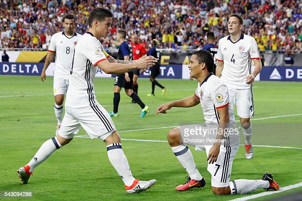 Carlos Bacca of Colombia celebrates with James Rodriguez after Bacca scored a first half goal against the United States during the 2016 Copa America...