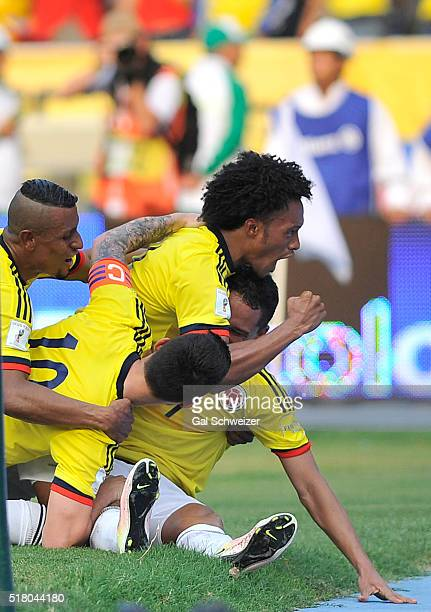 Carlos Bacca of Colombia celebrates with teammates after scoring the third goal of his team during a match between Colombia and Ecuador as part of...