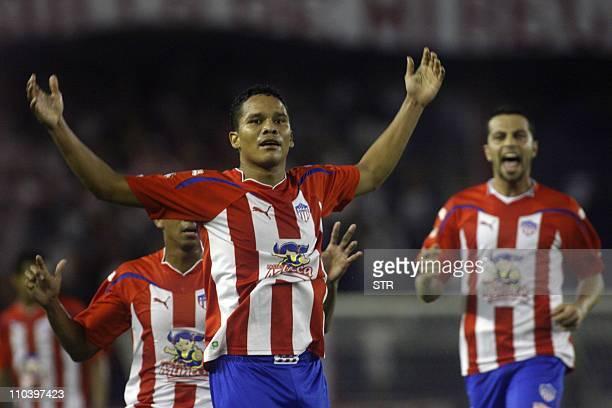 Carlos Bacca of Colombia's Junior de Barranquilla celebrates after scoring against Bolivia's Oriente Petrolero during their Copa Libertadores 2011...