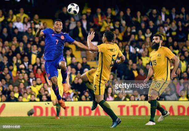 Carlos Bacca of Columbia battles for possesion with Mark Milligan of Australia during the International friendly between Australia and Colombia at...