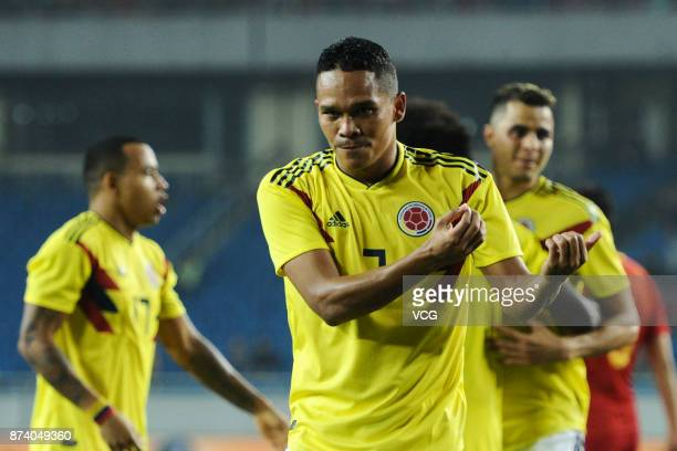 Carlos Bacca of Columbia National Team celebrates a point with teammates during the international friendly match between China and Columbia at...