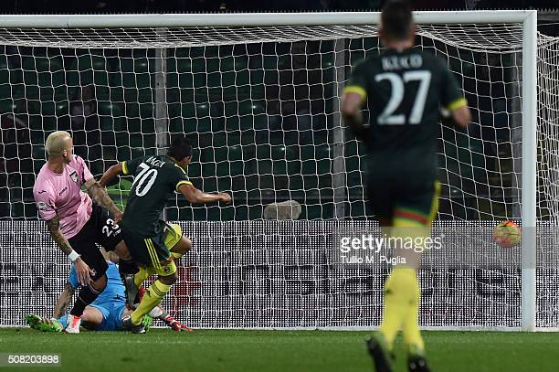 Carlos Bacca of Milan scores the opening goal during the Serie A match between US Citta di Palermo and AC Milan at Stadio Renzo Barbera on February 3...