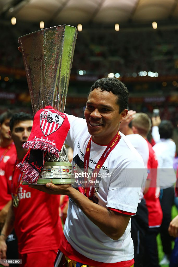 Carlos Bacca of Sevilla celebrates victory with the trophy after the UEFA Europa League Final match between FC Dnipro Dnipropetrovsk and FC Sevilla on May 27, 2015 in Warsaw, Poland.