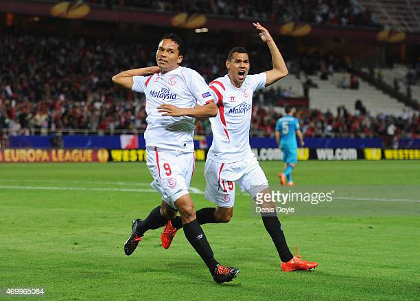 Carlos Bacca of Sevilla celebrates with Timothee Kolodziejczak as as he scores their first goal during the UEFA Europa League Quarter Final first leg...