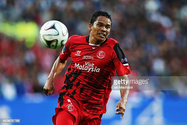 Carlos Bacca of Sevilla controls the ball during the UEFA Super Cup match between Real Madrid and Sevilla at Cardiff City Stadium on August 12 2014...