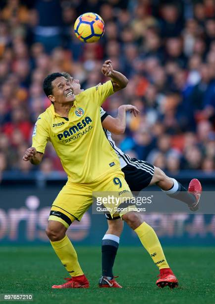 Carlos Bacca of Valencia competes for the ball with Lato of Villarreal during the La Liga match between Valencia and Villarreal at Mestalla Stadium...