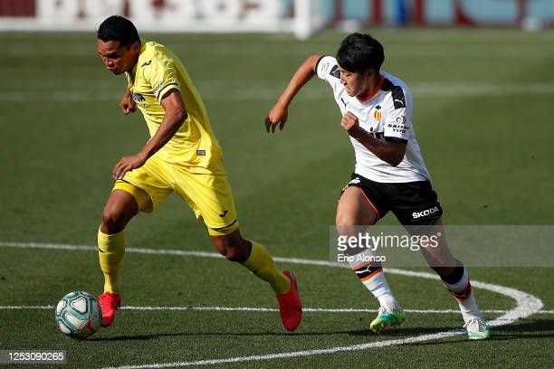 Carlos Bacca of Villareal is tracked by Lee Kang-In of Valencia during the Liga match between Villarreal CF and Valencia CF at Estadio de la Ceramica...