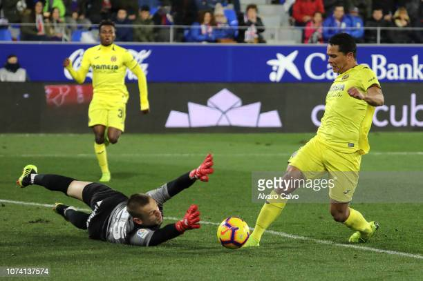 Carlos Bacca of Villarreal and Aleksandar Jovanovic of SD Huesca during the La Liga match between SD Huesca and CF Villarreal at El Alcoraz on...