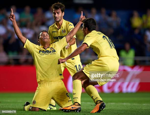 Carlos Bacca of Villarreal celebrates with his teammates after scoring the first goal during the La Liga match between Villarreal CF and Real Betis...