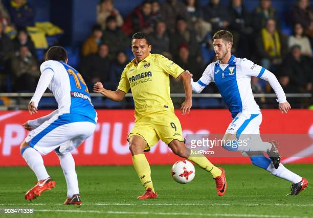 Carlos Bacca of Villarreal CF and Ruben Perez of Club Deportivo Leganes during the Spanish Copa del Rey Round of 16 match between Villarreal CF and...
